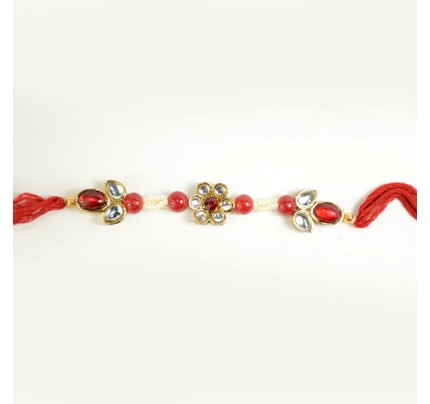Crafted Metal Rakhi with colorful stones